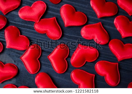 Red love hearts on a blue wooden background. Valentine's Day background. #1221582118