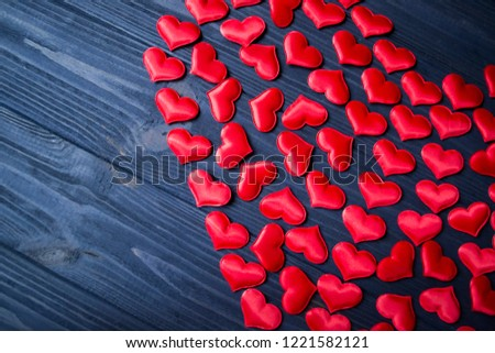 Red love hearts on a blue wooden background. Valentine's Day background. #1221582121