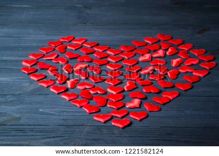 Red love hearts on a blue wooden background. Valentine's Day background. #1221582124