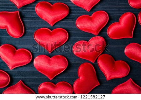 Red love hearts on a blue wooden background. Valentine's Day background. #1221582127