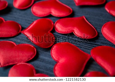 Red love hearts on a blue wooden background. Valentine's Day background. #1221582130