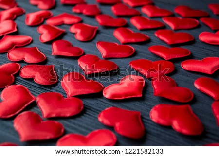 Red love hearts on a blue wooden background. Valentine's Day background. #1221582133