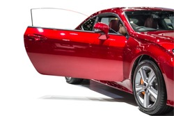 Red luxury car, Rear-side view of a luxury car, isolated background