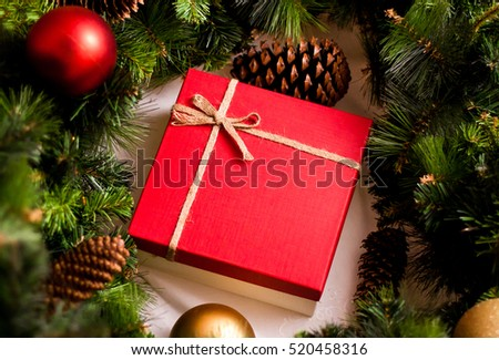 Red luxury New Year gift. Christmas gift. Happy New Year 2017. Christmas background with gift box. Christmastime celebration.