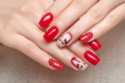 red manicure with rabbits