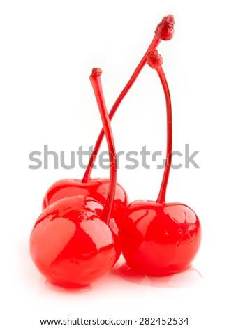 red maraschino cherries isolated on white background