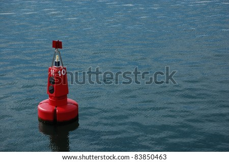 Red Marker Buoy in Sea.