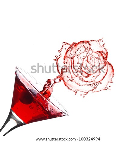 Red martini cocktail with splash rose