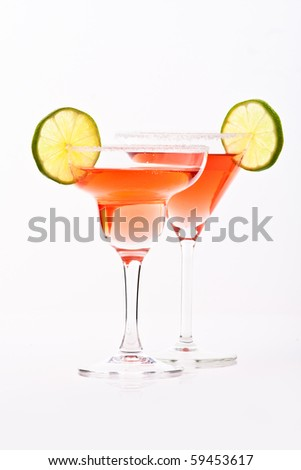 red martini in margarita and martini glasses decorated with lime