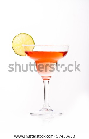 red martini in margarita glass decorated with lime