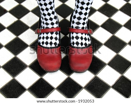 Tiling Bathroom Floor on Black And White Checkered Tights On Checkered Tile Floor   Stock Photo