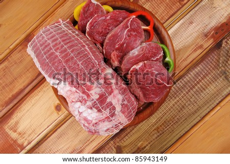 red meat on wooden table ready to cook