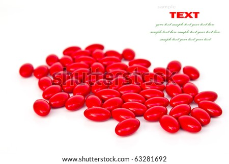 Red medicinal pills on a white background  with space for text