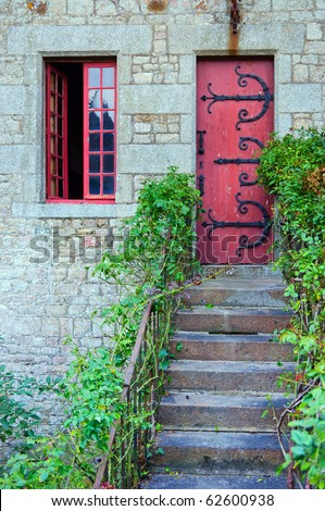 Red medieval door in Mont Saint Michel abbey in France