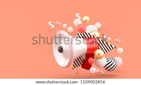 Red megaphone among colorful balls on pink background.-3d rendering.