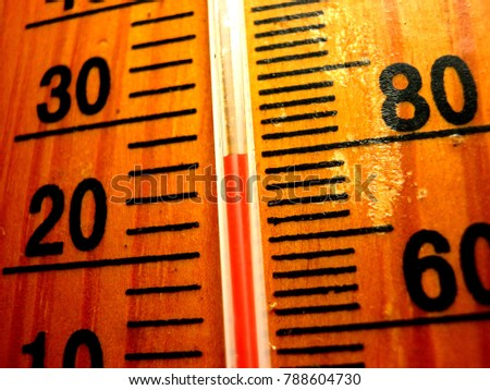red mercury in Thermometer got to 26 degree Celsius and 80 degree Fahrenheit on the brown wood scale