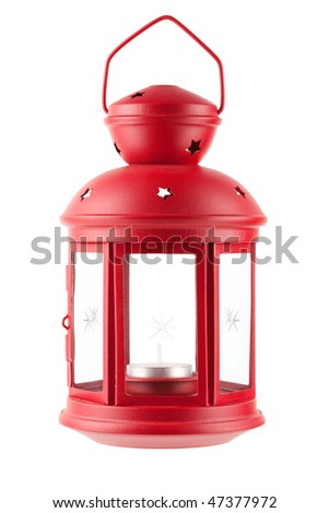 Red metal lamp with candle. Isolated on white background