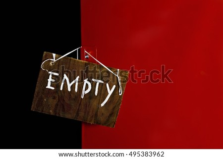 Red metal  safe door closed with a hand written message Empty, closeup shot #495383962