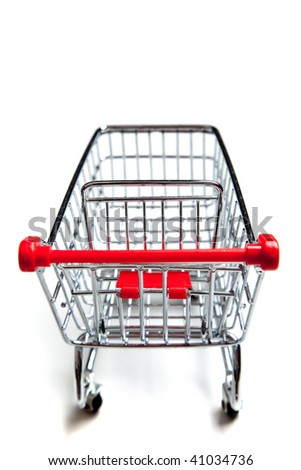 Red, metal supermarket shopping cart on a white background
