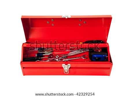 Red metal tool box with tools including hammer, tape measure, wrench, screwdriver on a white background
