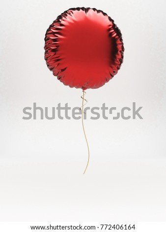 Red metallic round balloon with ribbon, isolated on white background
