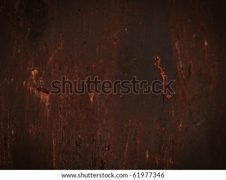Red metallic surface with rust