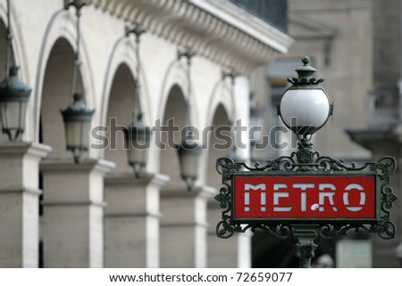 Red metro sign in Paris France