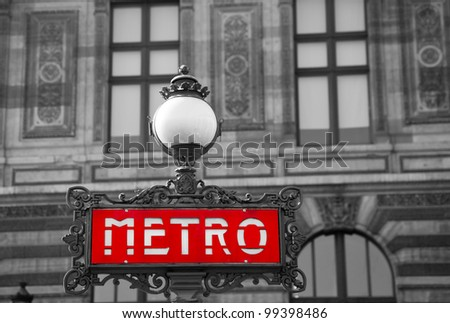 Red metro sign with black and white background, Paris, France