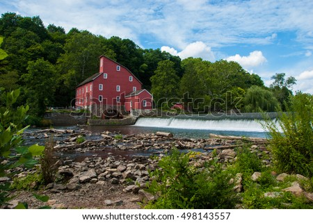 Red Mill beside a River