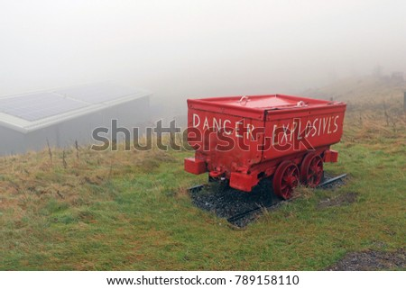 "Red Mining Cart with words ""DANGER EXPLOSIVES"" on Misty Mountain Top #789158110"