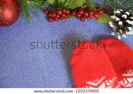 red mittens and christmas decoration on wooden background #1203374905