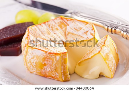 Red molded soft french cheese - stock photo