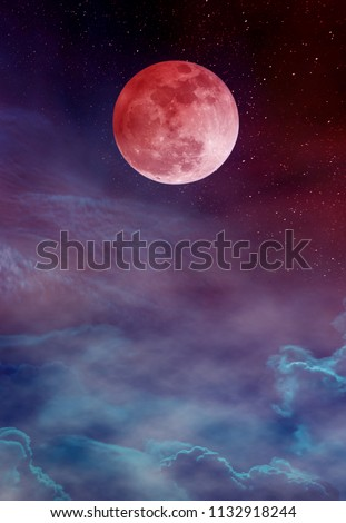 Red moon or blood moon with many stars and clouds. Beautiful night landscape with full moon on colorful sky. Serenity nature background. The moon taken with my camera.