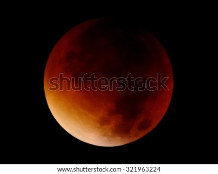 Red moon - the final phase of a total lunar eclipse 27-28 september 2015. View from the territory of Italy, Sicily. #321963224
