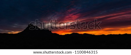 Red Mountain Sunrise - A panoramic landscape of a brilliant sunrise over Red Mountain in Mesa, Arizona.