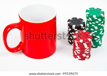 Red mug and poker chips over white background - stock photo