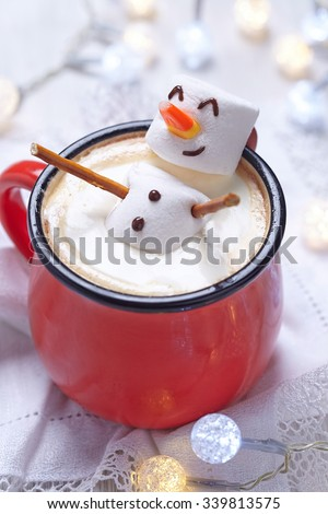 Red mug with hot chocolate with melted marshmallow snowman #339813575