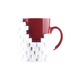 Red mug with sugar on a white background