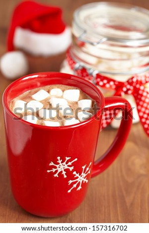 Red mugs with hot chocolate and marshmallows