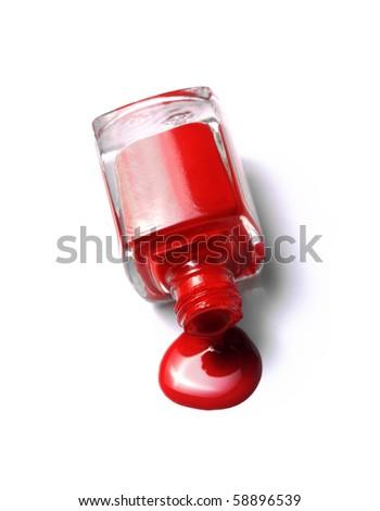 red nail polish bottle on white background