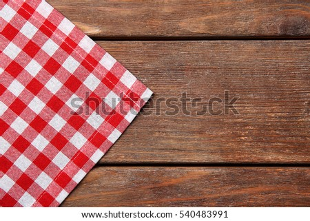 Red napkin on wooden table #540483991