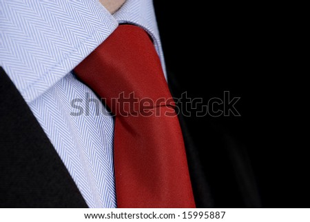 red necktie and suit close up