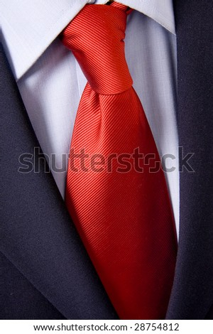 red necktie, black suit and blue collar detail