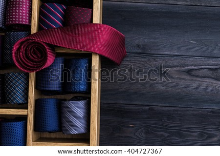 red necktie on top of collection of coiled neckties on display, copy space Stock foto ©
