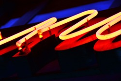 Red neon light (closeup on old sign)