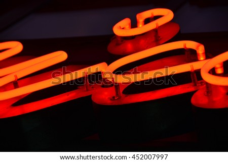 Red neon light (closeup on some letters) #452007997