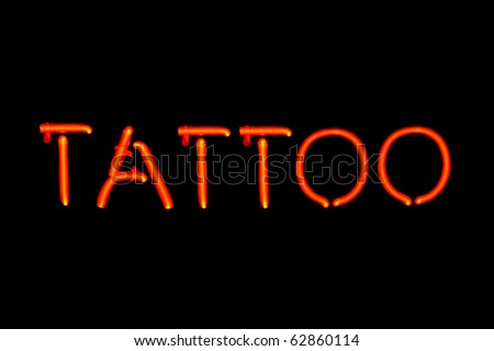 neon tattoo signs. stock photo : Red neon sign of