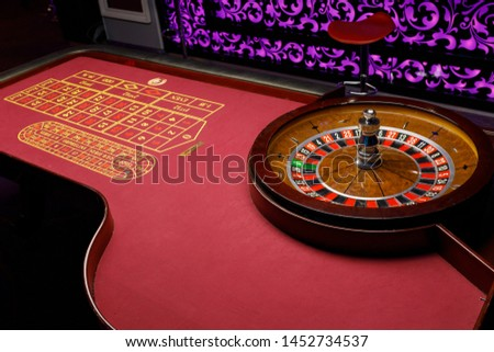 red new poker table with roulette at a tournament on cards #1452734537