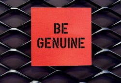 red note on wall with text BE GENUINE , self reminder to be yourself , truly what something authentic , be real and what it appears to be