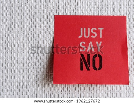 Red note on wallpaper background with text JUST SAY NO , learn to say no without fear of rejection, trapped ,recentful or guilty. Be more assertive and stand up for self Photo stock ©